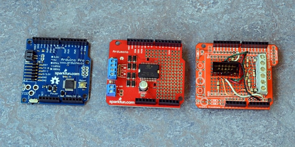 L to R: Arduino Pro microcontroller, Sparkfun Ardumoto board with L298 motor controller, protoboard with connectors for front-panel board and layout IR sensors.